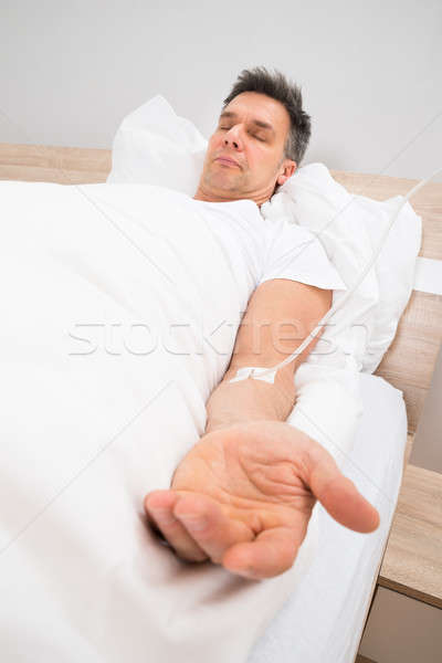 Stock photo: Patient Resting On Bed With Iv Drip