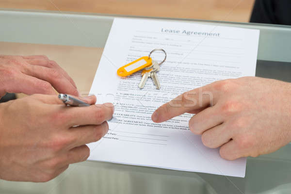 Person Signing Lease Agreement Stock photo © AndreyPopov