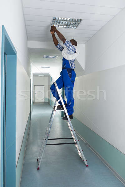 Electrician Installing Light On Ceiling Stock photo © AndreyPopov