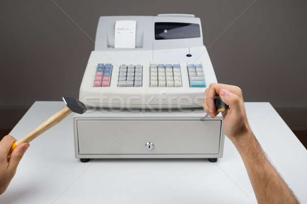 Person Hands With Worktool And Cash Register Stock photo © AndreyPopov
