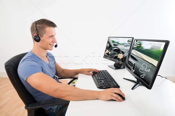 Man With Headset Playing Game On Computer Stock photo © AndreyPopov