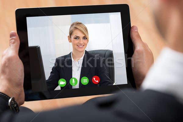 Businessperson Videochatting On Digital Tablet Stock photo © AndreyPopov