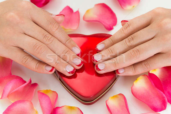 Woman Hands With Nail Varnish On Make-up Box Stock photo © AndreyPopov