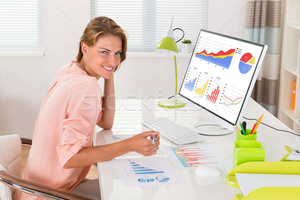 Woman Analyzing Financial Graphs Stock photo © AndreyPopov