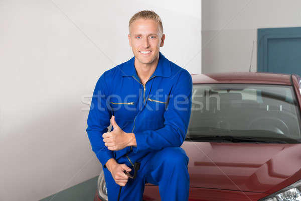Happy Young Mechanic Holding Wrench Stock photo © AndreyPopov