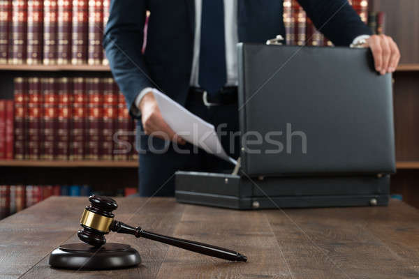Stock photo: Lawyer Putting Documents In Briefcase
