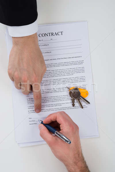 Real Estate Agent Assisting Client To Sign Contract Paper Stock photo © AndreyPopov