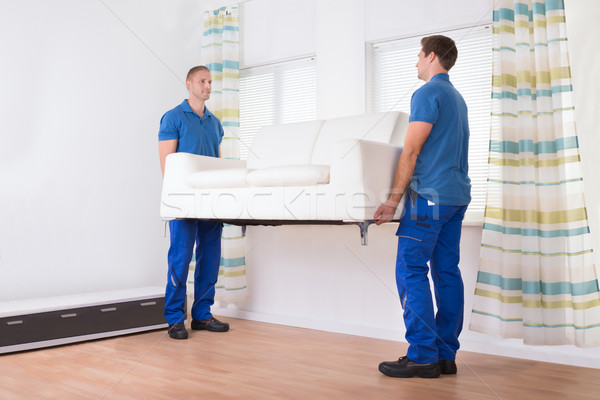 Movers Carrying Sofa At Home Stock photo © AndreyPopov