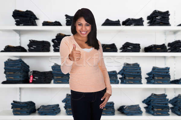 Woman Showing Thumbs Up Sing In Clothing Store Stock photo © AndreyPopov