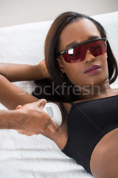 Therapist Removing Hair Of Young Woman's Armpit Stock photo © AndreyPopov