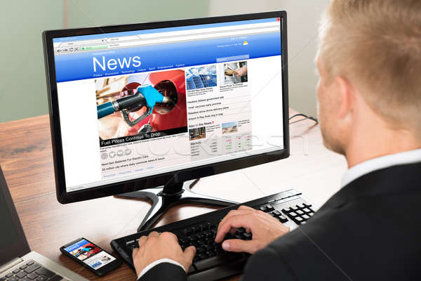 Stock photo: Businessman Reading News
