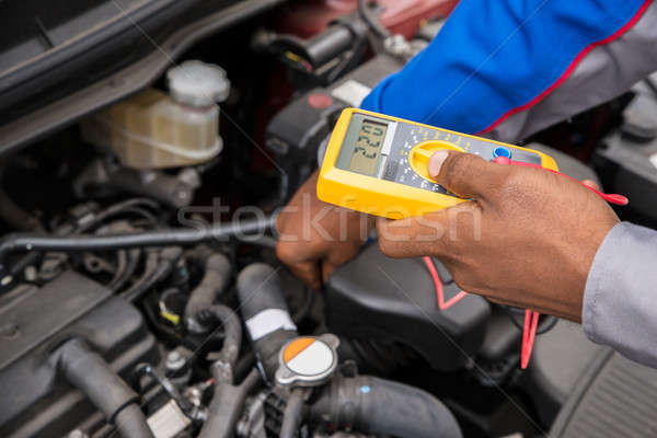 Mechanic Checking Battery With Multimeter Stock photo © AndreyPopov