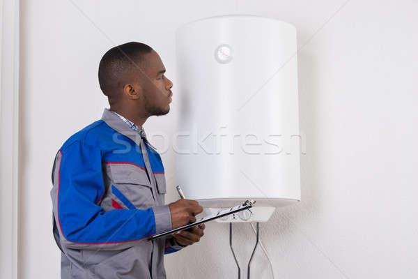 Foto stock: Encanador · olhando · elétrico · jovem · africano · masculino