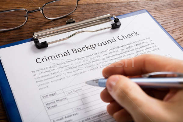 Person Filling Criminal Background Check Application Form Stock photo © AndreyPopov