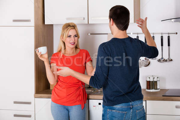 Couple Having Conversation In Kitchen Stock photo © AndreyPopov