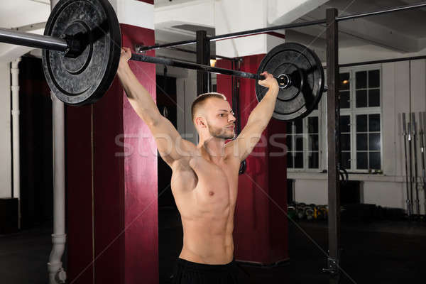 Young Man Working Out With Barbell Stock photo © AndreyPopov