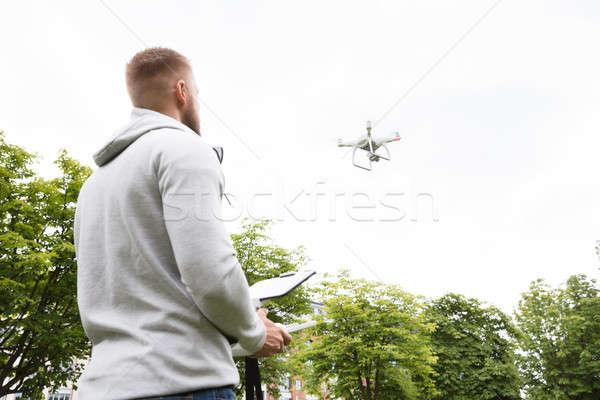 Man Flying Drone Stock photo © AndreyPopov