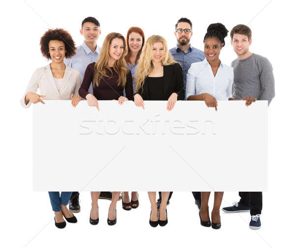 Stock photo: Group Of College Students Holding Long Billboard