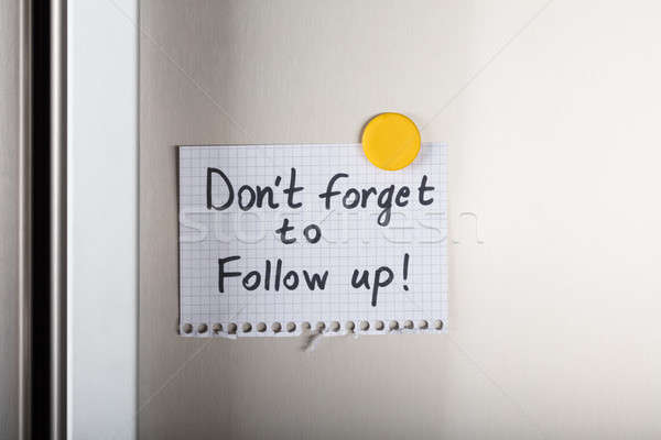 Don't Forget To Follow Up Note With Yellow Magnetic Thumbtack Stock photo © AndreyPopov