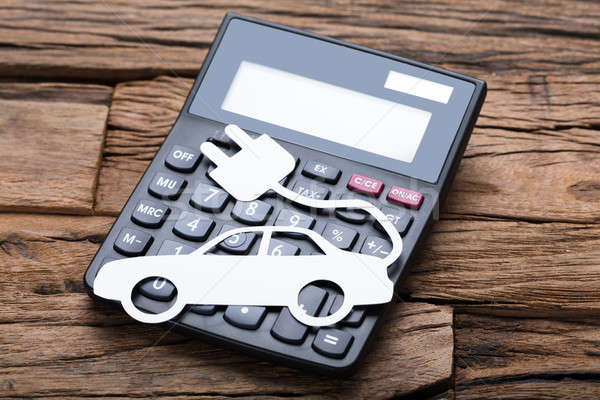 Paper Electric Car On Calculator At Wooden Table Stock photo © AndreyPopov