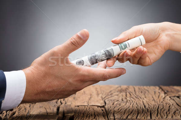 Businessperson Giving Bribe To Partner Stock photo © AndreyPopov