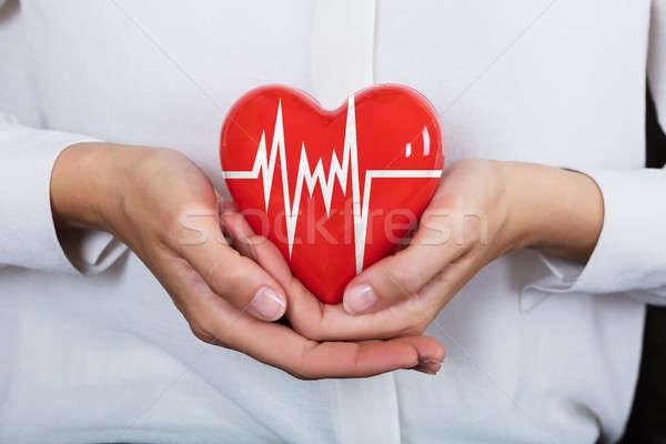 Person Holding Heart Stock photo © AndreyPopov
