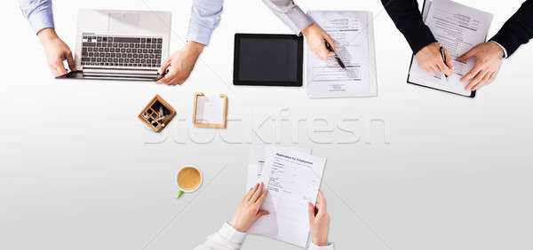 Businesspeople Checking Applicant's Resume In Office Stock photo © AndreyPopov