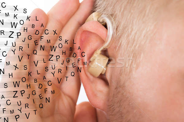 Man Holding Hand Near Ear Listening Carefully Alphabet Letters Stock photo © AndreyPopov