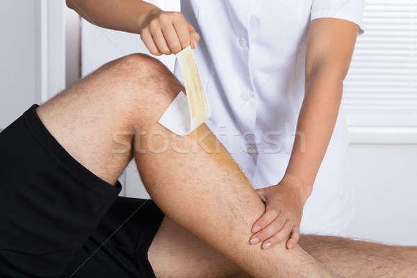 Therapist Waxing Man's Leg Stock photo © AndreyPopov