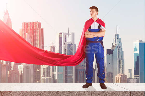 Janitor In Superhero Costume Standing On Top Of Building Stock photo © AndreyPopov
