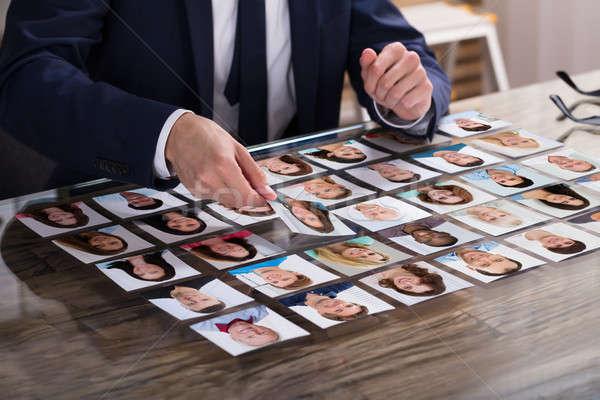 üzletember választ fénykép jelölt közelkép asztal Stock fotó © AndreyPopov
