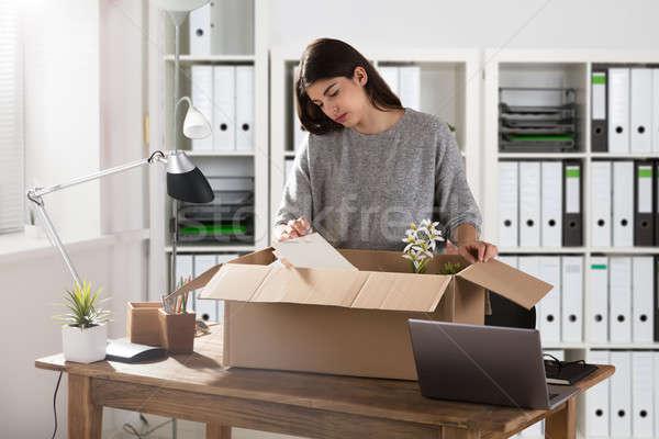 Businesswoman Packing Her Belongings In Cardboard Box Stock photo © AndreyPopov