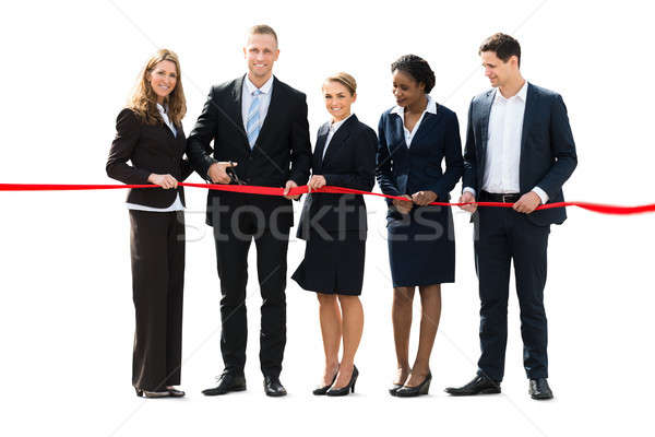 Businesspeople Cutting Red Ribbon With Scissors Stock photo © AndreyPopov