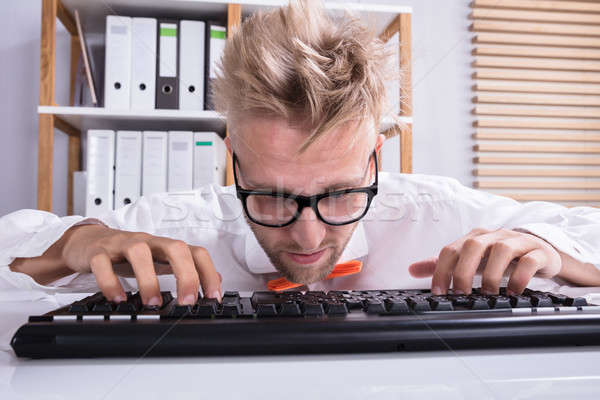 Concentrating Businessman Typing On Keyboard Stock photo © AndreyPopov