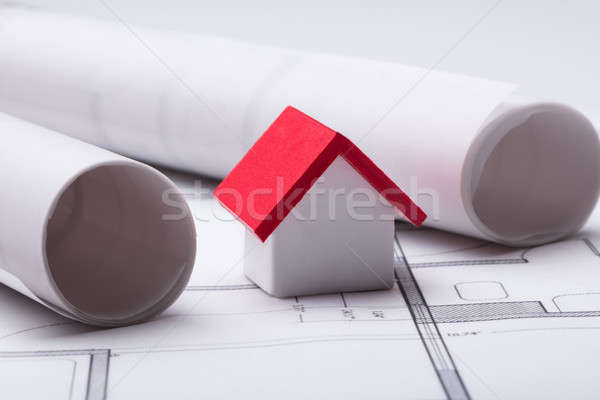 House Model With Rolled Blueprint Stock photo © AndreyPopov