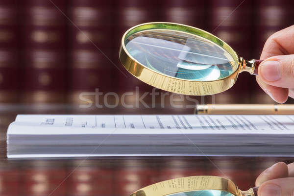 Person Looking At Document With Magnifying Glass Stock photo © AndreyPopov