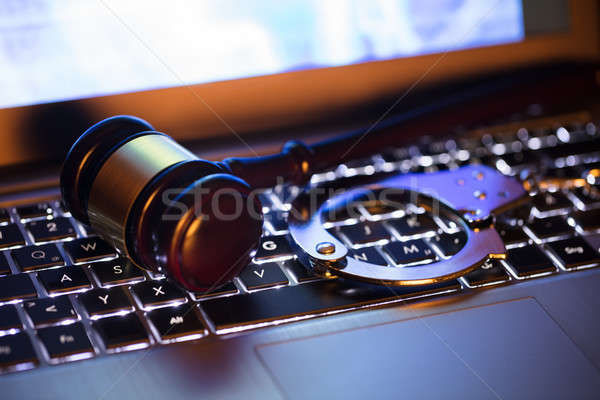 Close-up Of A Gavel And Handcuff Stock photo © AndreyPopov
