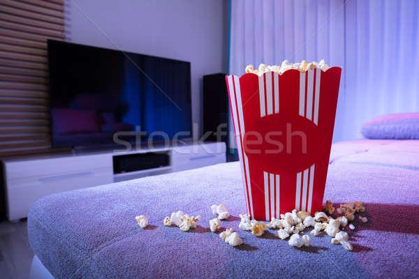 Patlamış mısır kanepe oturma odası gece ev Stok fotoğraf © AndreyPopov