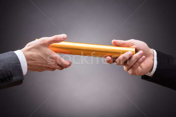 Person Passing Baton To Businessperson Stock photo © AndreyPopov