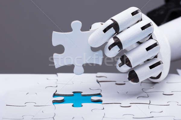 Robot kirakós játék közelkép robotikus kéz üzlet Stock fotó © AndreyPopov