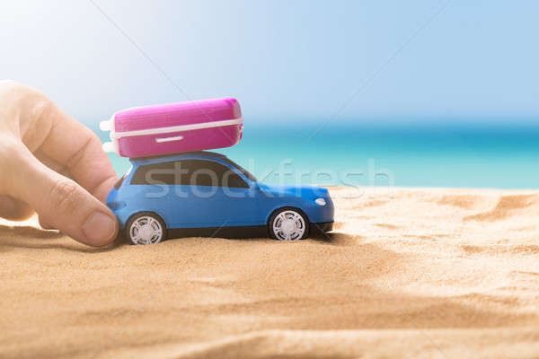 Person Holding Blue Car With Luggage Stock photo © AndreyPopov