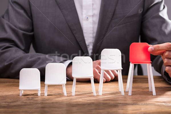 Mano umana rosso sedia bianco Foto d'archivio © AndreyPopov