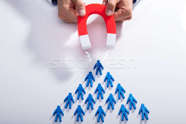 Stock photo: Businessman Attracting Blue Team With Horseshoe Magnet