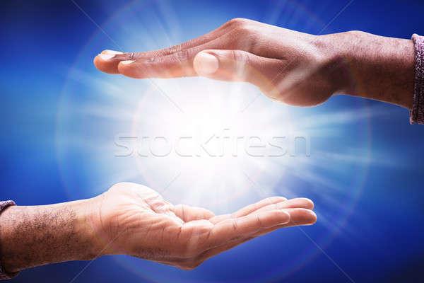 Masculino mão luz solar labareda homens Foto stock © AndreyPopov