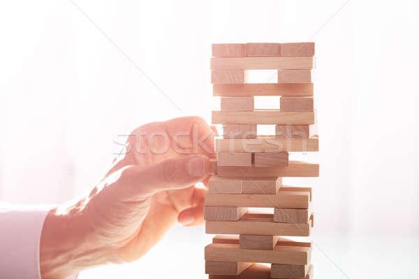 Businessman Stacking Wooden Blocks Stock photo © AndreyPopov