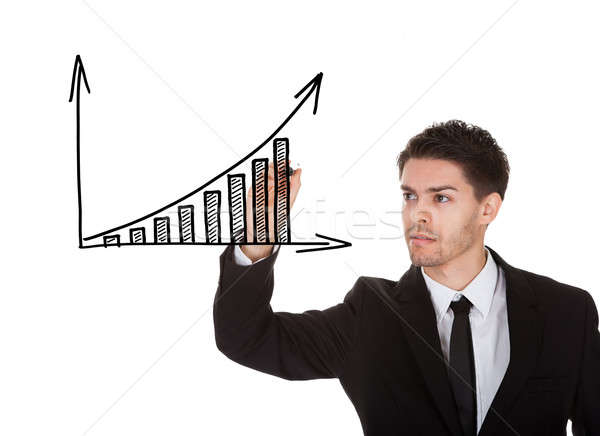 Hand writing on profit growth chart blackboard Stock photo © AndreyPopov