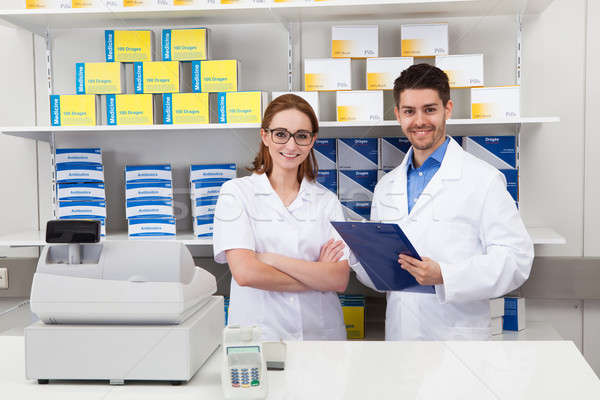 Two Pharmacist Working In Pharmacy Stock photo © AndreyPopov