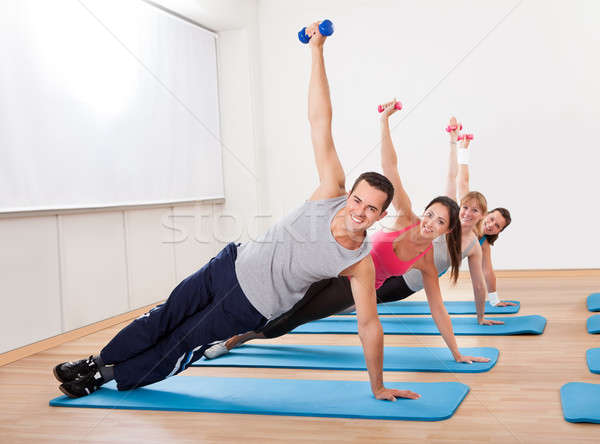 Large group of people working out in a gym Stock photo © AndreyPopov