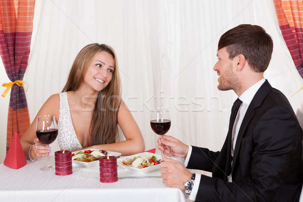 Loving couple enjoying a romantic meal Stock photo © AndreyPopov