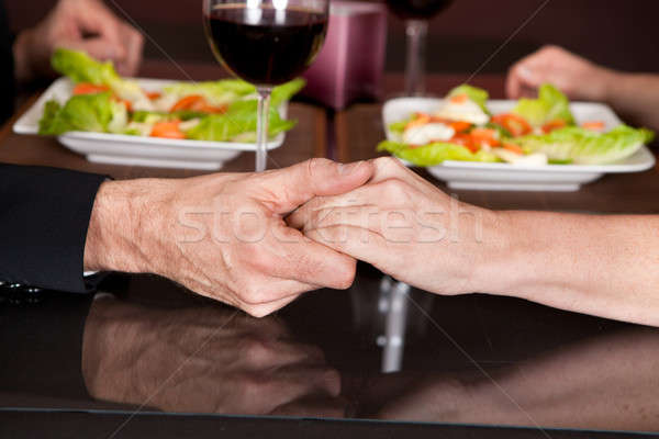 Touching hands at romantic dinner in restaurant Stock photo © AndreyPopov